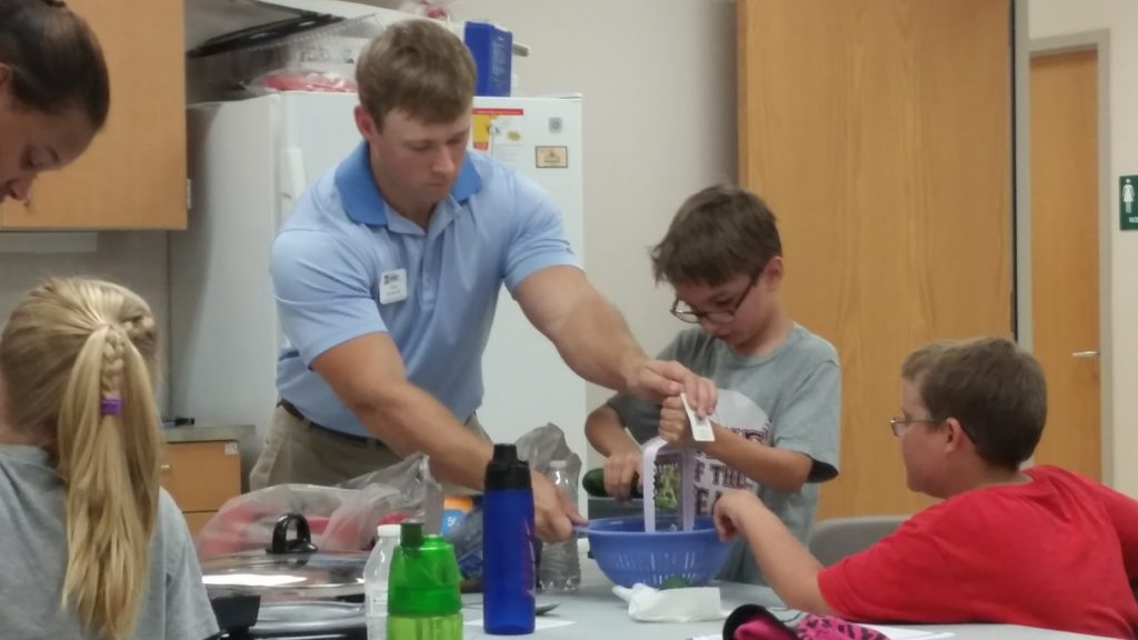 Harnett County FCS Agent, Greg Huneycutt teaching food safety to 4-H members.